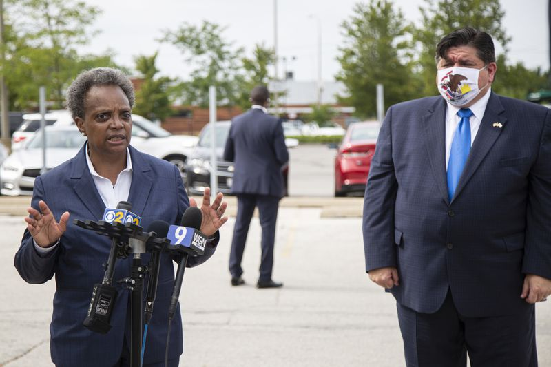Mayor Lori Lightfoot, left, and Gov. J.B. Pritzker, right, at a news conference in Morgan Park in August.