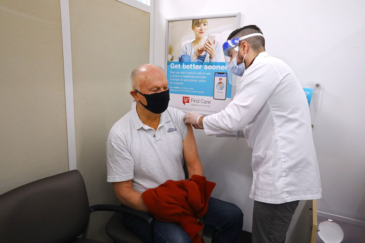 A person getting vaccinated at a Walgreens Pharmacy.