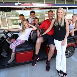 From left, Luc, Finley, Cameron, Ben, Larry, Jan and Sam Krystkowiak pose for a family photo at the University of Utah in Salt Lake City on Friday, June 12, 2015.
