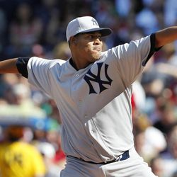 New York Yankees' Ivan Nova pitches in the first inning of a baseball game against the Boston Red Sox at Fenway Park in Boston, Friday, April 20, 2012. To celebrate the 100th birthday of Fenway Park, players wore uniforms replicating the ones worn in 1912.