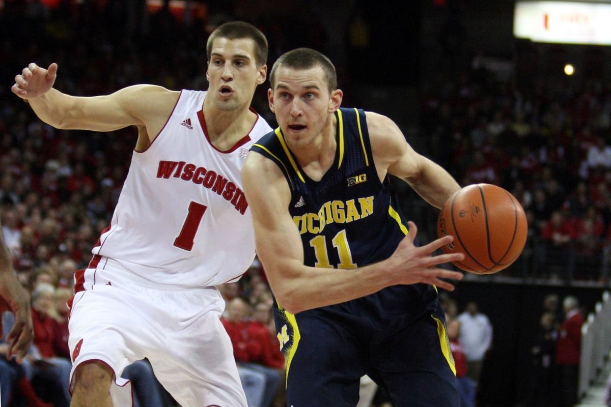 Jan 18, 2014; Madison, WI, USA; Michigan Wolverines guard Nik Stauskas (11) looks to shoot as Wisconsin Badgers guard Ben Brust (1) defends during the first half at the Kohl Center. Mandatory Credit: Mary Langenfeld-USA TODAY Sports