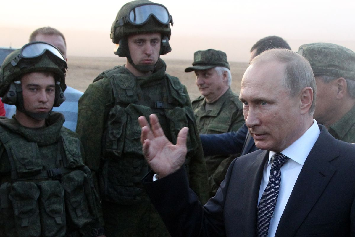 Russian President Vladimir Putin observing military exercises in Russia.