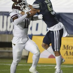 Brigham Young Cougars wide receiver Dax Milne (5) and Texas State Bobcats safety Zion Childress (11) compete for a pass in Provo on Saturday, Oct. 24, 2020.
