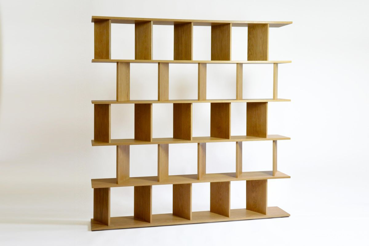 Wooden book shelf with slanted sections.