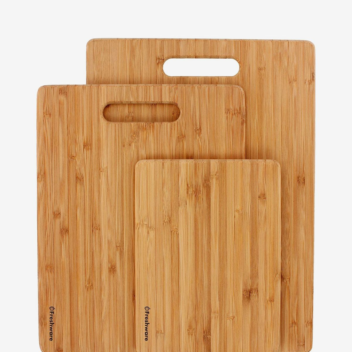 A set of three wooden cutting boards in varying sizes
