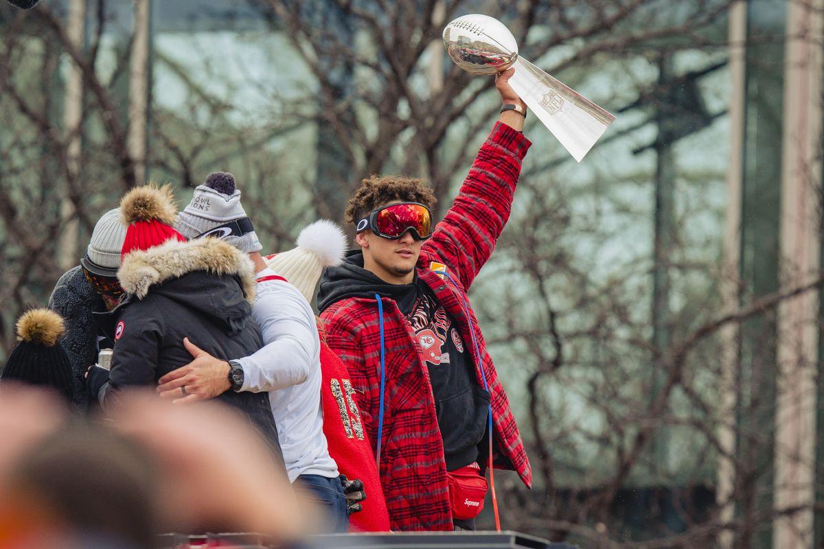 Patrick Mahomes #15 of the Kansas City Chiefs hoists the Super Bowl Trophy during the Kansas City Super Bowl parade on February 5, 2020 in Kansas City, Missouri.