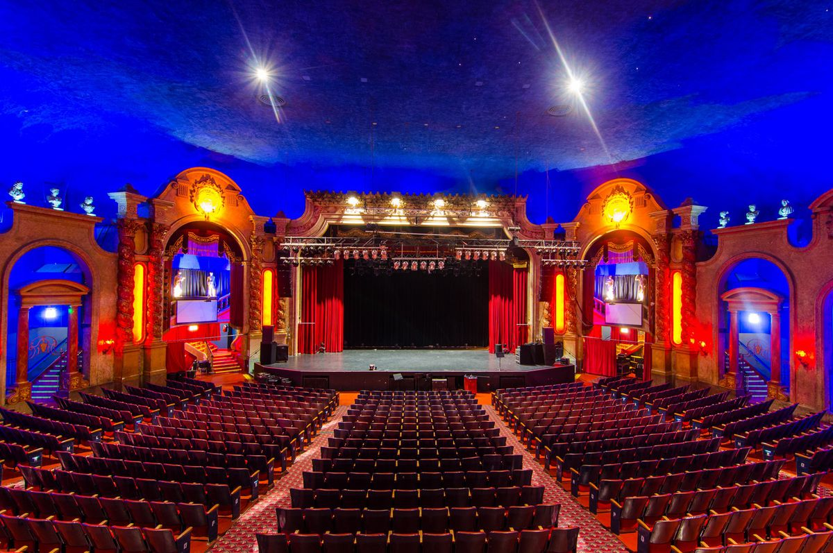 An ornate auditorium with a stage and seating for 2,000 people.