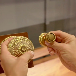 Alison Victoria shows off the doorknobs she chose for the house.   HGTV
