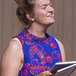 """Meleeza Hall tilts her head back in worship while singing """"Everlasting God"""" during the 9:30 a.m. nondenominational Christian church service in Bryce Canyon National Park, Sunday, June 18, 2017."""