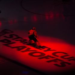 Holtby Glides Over Red Lit Ice
