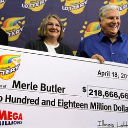 Merle and Patricia Butler, of Red Bud, Ill., pose with a novelty check during a news conference at the Red Bud Village Hall on Wednesday, April 18, 2012 in Red Bud, Ill. The retired southern Illinois couple has claimed the third and final share of last month's record $656 million Mega Millions jackpot.