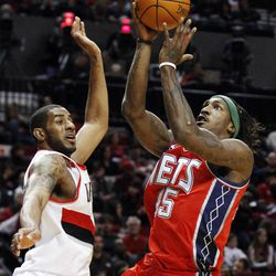 New Jersey Nets' Gerald Wallace (45) goes to the basket as Portland Trail Blazers' LaMarcus Aldridge (12) defends in the second quarter of an NBA basketball game, Wednesday, April 4, 2012, in Portland, Ore.