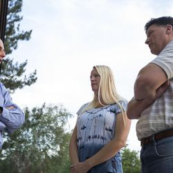 Local LDS Bishop Mark Hale, left, Christina Hamer and Joe Harmer talk outside an LDS meetinghouse in Sandy  on Thursday, June 8, 2017, after an interfaith gathering to comfort the community following Tuesday's deadly shooting.