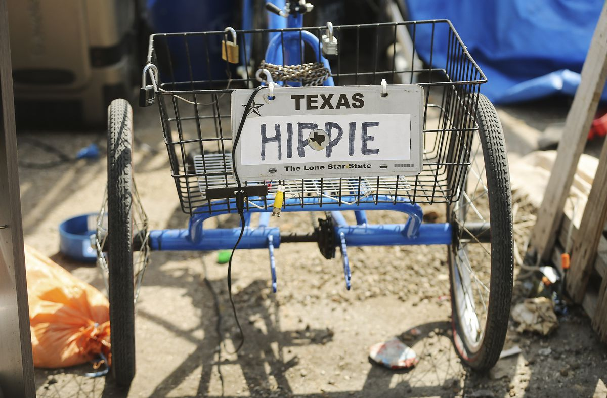 "Donald ""Hippie"" Montgomery uses a bicycle to deliver supplies to residents at Camp Esperanza homeless camp in Austin, Texas, on Tuesday Oct 20, 2020."