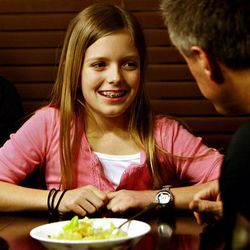 Kylie Whittingham has a chat with her dad, Kyle, during dinner at their home in Sandy.