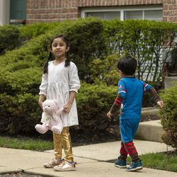 Maryam Rizvi and her younger brother Idris play in their front yard, Tuesday, April 28, 2020.