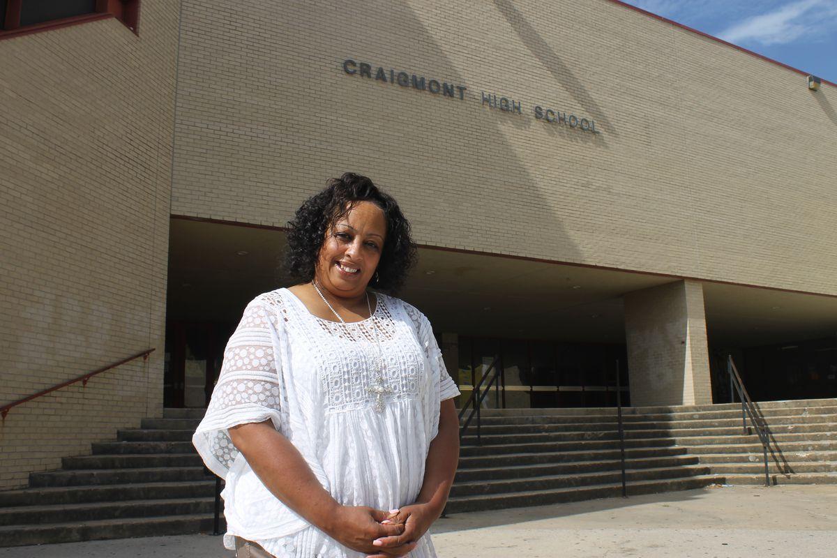 Principal Tisha Durrah stands at the entrance of Craigmont High.
