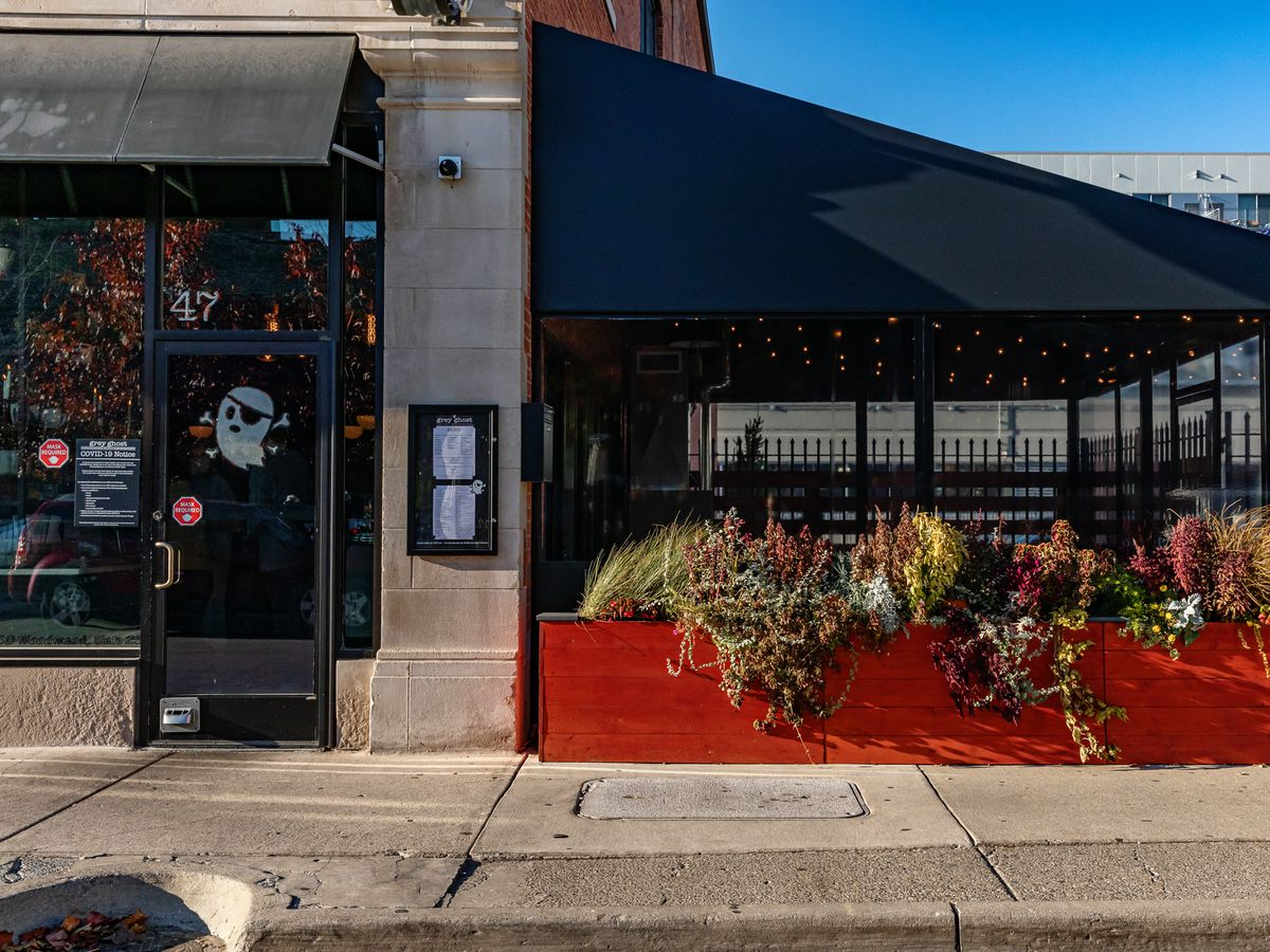 The exterior of Grey Ghost and its enclosed patio on a sunny fall day.