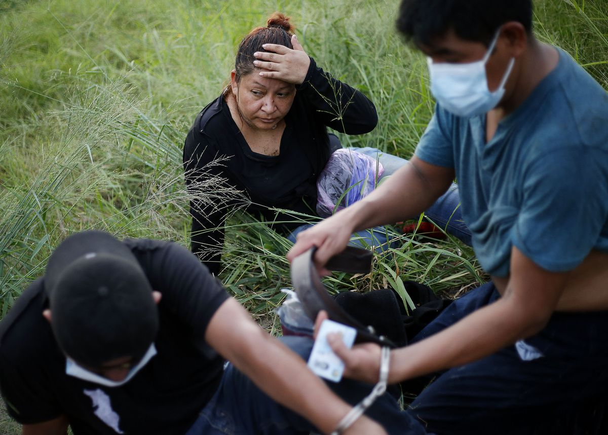 Undocumented migrants are detained by Border Patrol agents near McAllen, Texas, on Tuesday, June 22, 2021.