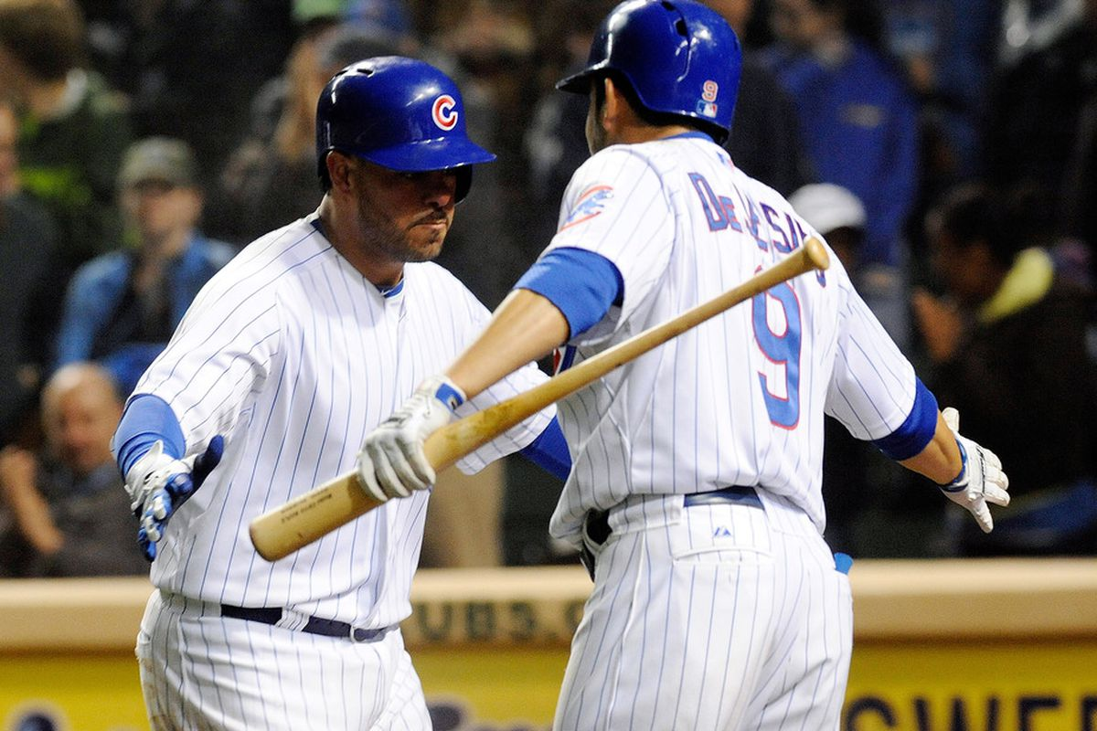 Or, write your own caption: Geovany Soto of the Chicago Cubs gets congratulated by David DeJesus after hitting a two run homer at Wrigley Field in Chicago, Illinois.The Chicago Cubs defeated the Atlanta Braves 5-1. (Photo by David Banks/Getty Images)