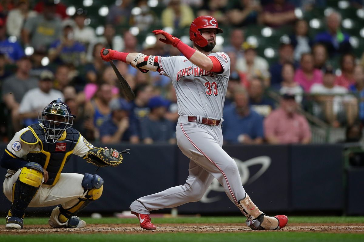 Jesse Winker of the Cincinnati Reds swings at a pitch against the Milwaukee Brewers at American Family Field on June 14, 2021 in Milwaukee, Wisconsin. Reds defeated the Brewers 10-2.