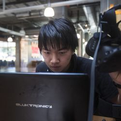 """Conan Zhang, co-founder and CEO of the virtual reality startup business Grace Foundry, sets up a demonstration at the Lassonde Studios on the University of Utah campus in Salt Lake City on Friday, June 23, 2017. Zhang and his peers are working on making different """"worlds"""" to experience while listening to music, like underwater worlds or in the sky."""