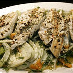 """Grilled Branzino with Fennel and Tangerines is featured in Tyler Florence's """"Eat This Book."""" The recipe can be made with other kinds of fish."""