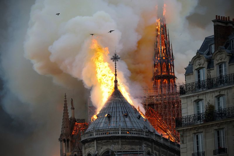 Smoke and flames rise during a fire at the Notre Dame Cathedral in central Paris on April 15, 2019, potentially involving renovation work being carried out at the site, the fire service said.