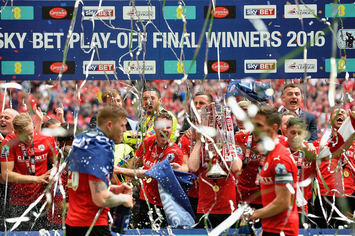 Who will follow in the footsteps of Barnsley, Burton and Wigan in promotion from League One this season?