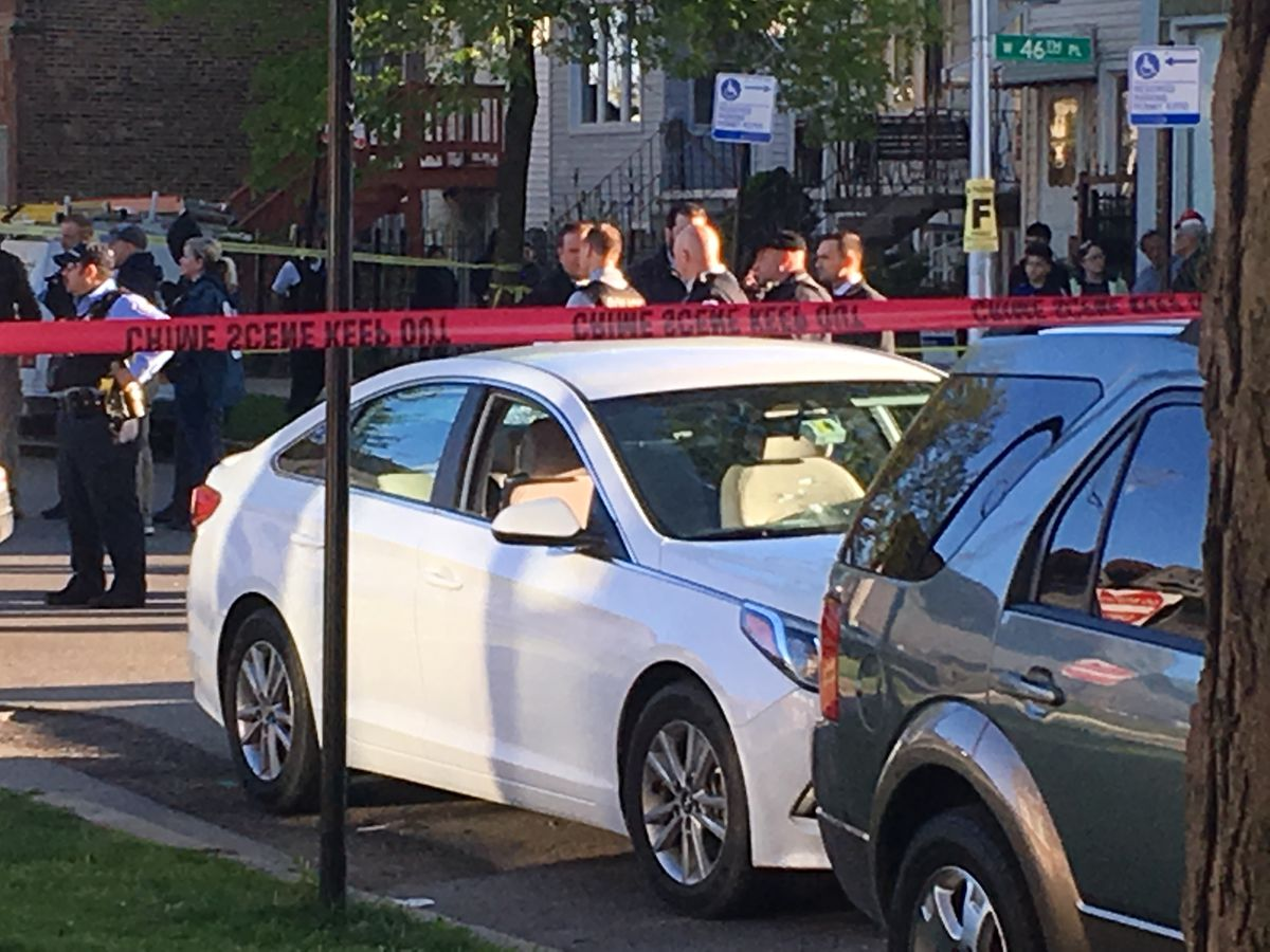 Bullet holes are seen in the front windshield of a white car on Rockwell at 46th Street. The back window also was broken. | Lauren FitzPatrick/Sun-Times