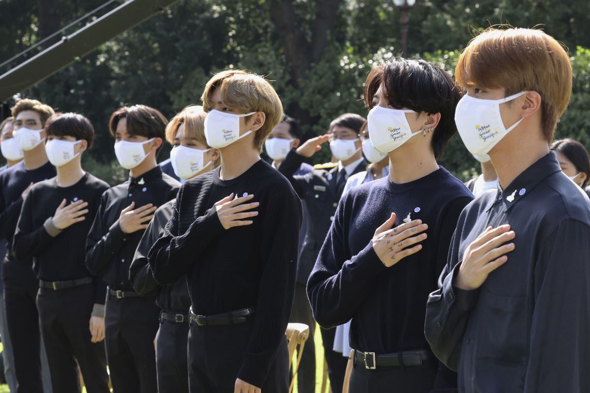 In this Sept. 19, 2020, file photo, K-pop group BTS salutes to their national flag during a ceremony marking the National Youth Day at the presidential Blue House in Seoul, South Korea. BTS released a statement Tuesday condemning racism against Asians and Asian Americans and Pacific Islanders.