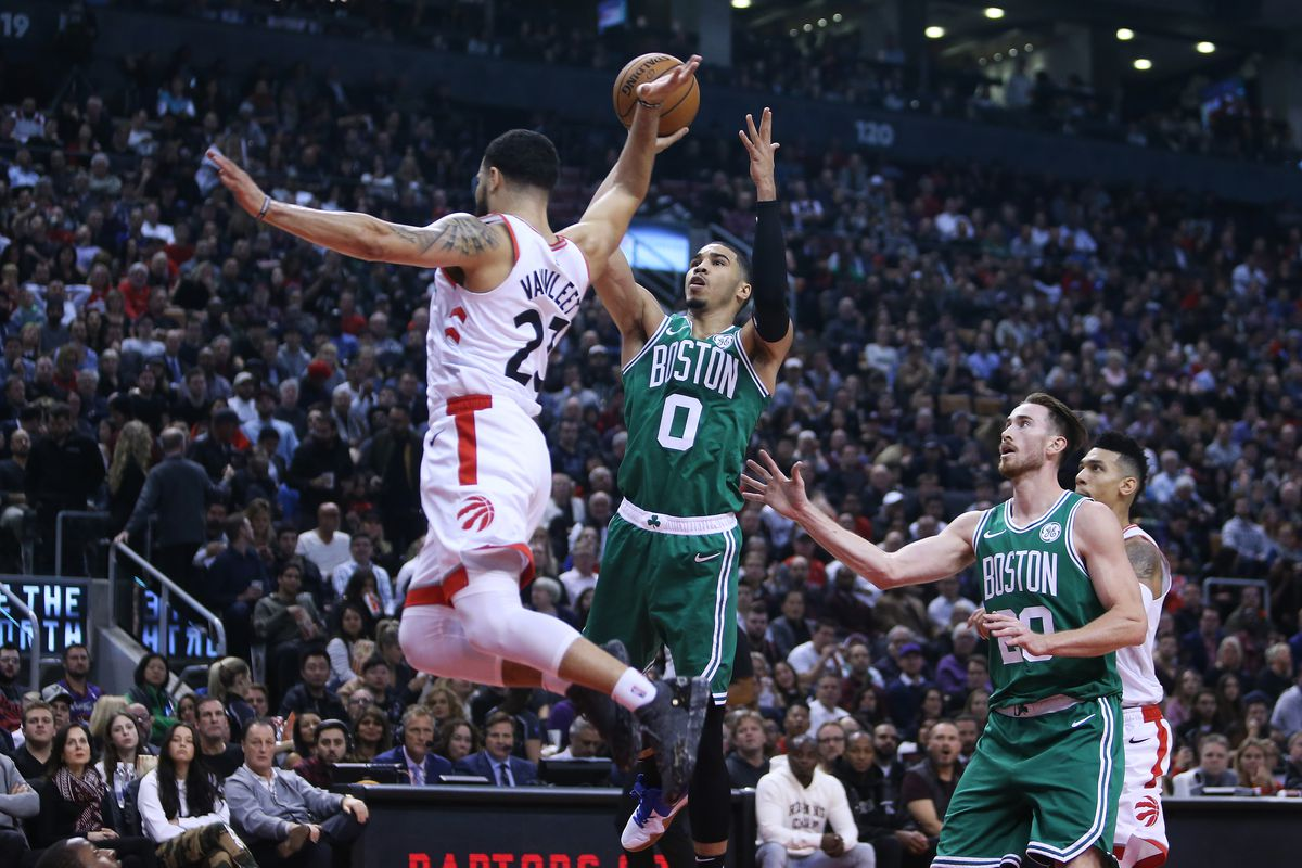 Jayson Tatum of the Boston Celtics shoots the ball as Fred VanVleet of the Toronto Raptors defends during the first half of an NBA game at Scotiabank Arena on October 19, 2018 in Toronto, Canada.