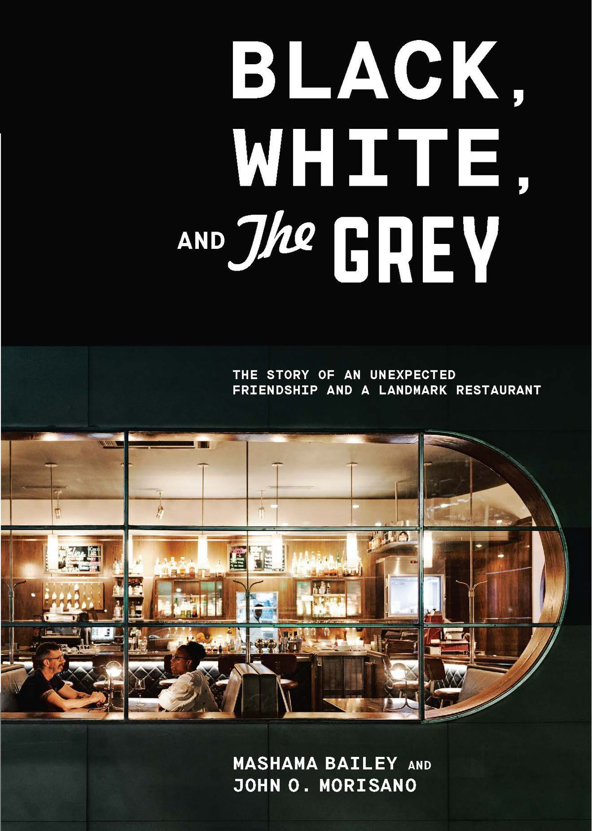 A book cover featuring a photo taken through the window of a well-lit restaurant dining room in which a white man, John O. Morisano, and a black woman, Mashama Bailey, sit at a booth