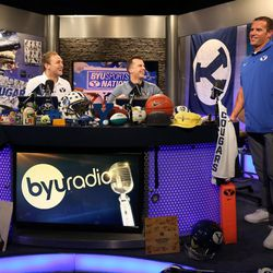 Luke Staley, right, laughs after an interview with BYU Sports Nation radio hosts Spencer Linton, left, and Jarom Jordan during BYU Football Media Day at BYU Broadcasting in Provo on Friday, June 23, 2017. Staley's jersey number (6) was retired.