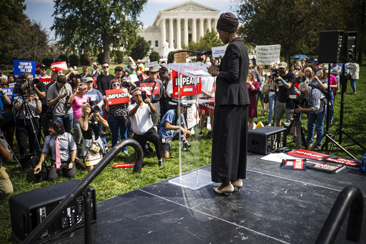 Rep. Ilhan Omar speaks at an impeachment rally.