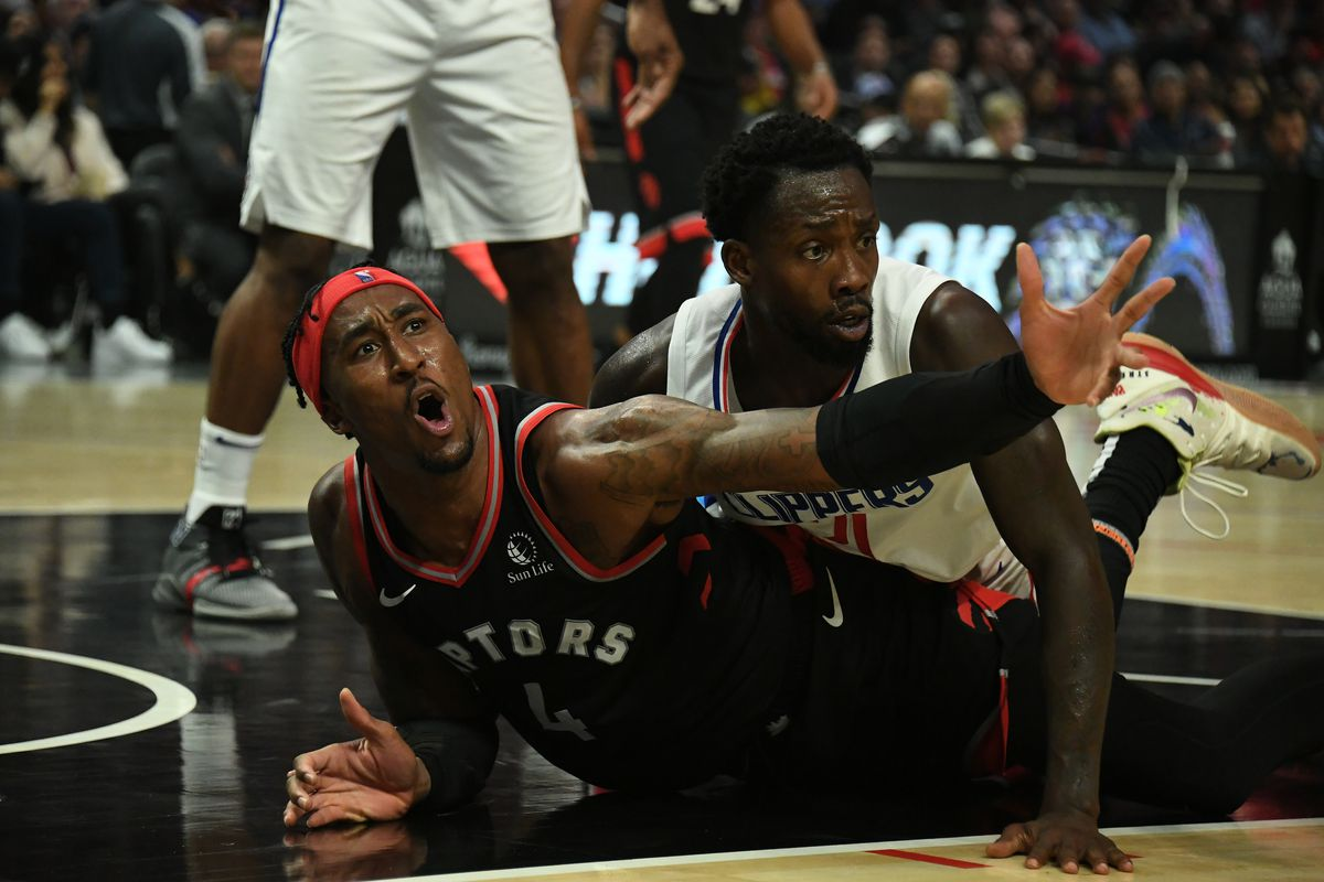 Toronto Raptors forward Rondae Hollis-Jefferson reacts to a no call during a scramble for a loose ball on the floor against LA Clippers guard Patrick Beverley at Staples Center.