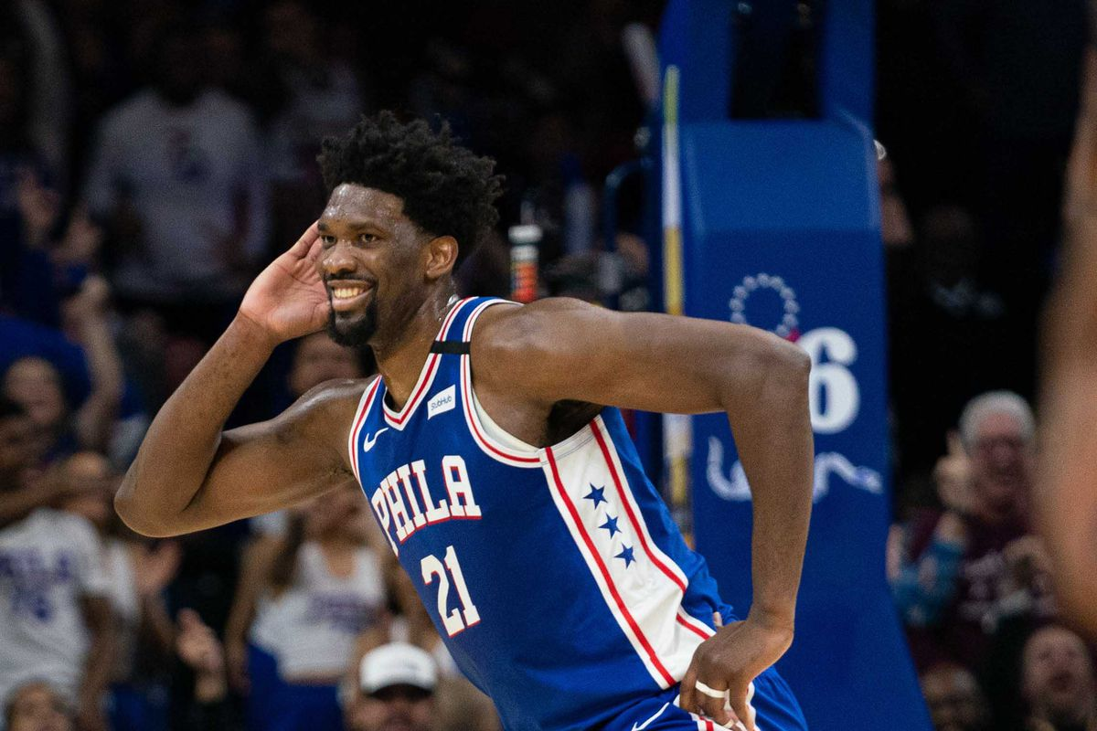 Philadelphia 76ers center Joel Embiid reacts after his three point score against the Atlanta Hawks during the fourth quarter at Wells Fargo Center.