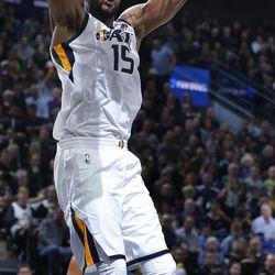 Utah Jazz forward Derrick Favors dunks the ball against the Oklahoma City Thunder during NBA basketball in Salt Lake City on Saturday, Dec. 23, 2017.