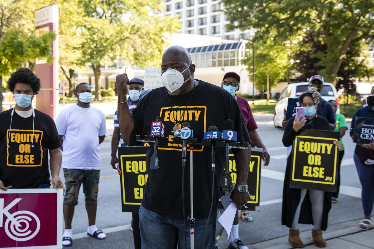 Jitu Brown, director of Journey 4 Justice, and a group of activists speak out against the planned closure of Mercy Hospital & Medical Center in Bronzeville.