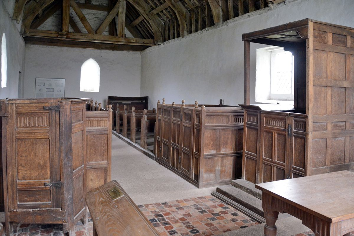 Interior view of the Langley Puritan Chapel shows the pulpit (left), reading desk (upper right) and communion table (lower right).