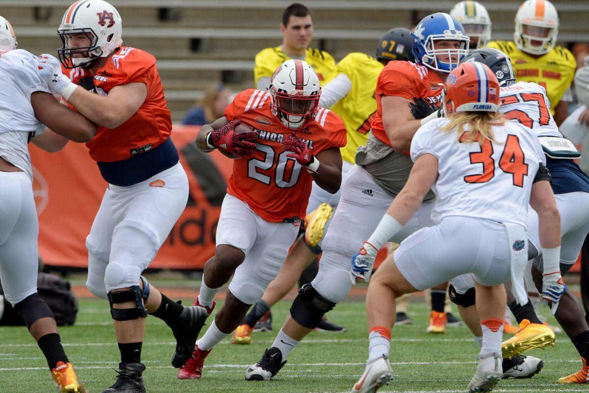 MOBILE, AL:  South squad linebacker Alex Anzalone of Florida (34) runs to fill his gap against running back Matt Dayes of North Carolina State (20) during Senior Bowl practice at Ladd-Peebles Stadium.