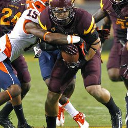 Arizona State linebacker Carlos Mendoza runs back an interception as Illinois wide receiver Darius Millines (15) defends during the first half of an NCAA college football game, Saturday, Sept. 8, 2012,in Tempe, Ariz.