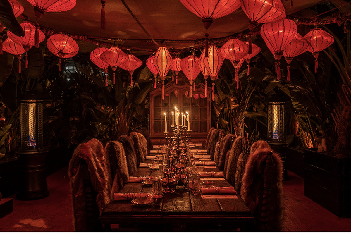 The ornate, plush red interior of the private dining room at Lost Spirits Distillery in Los Angeles.