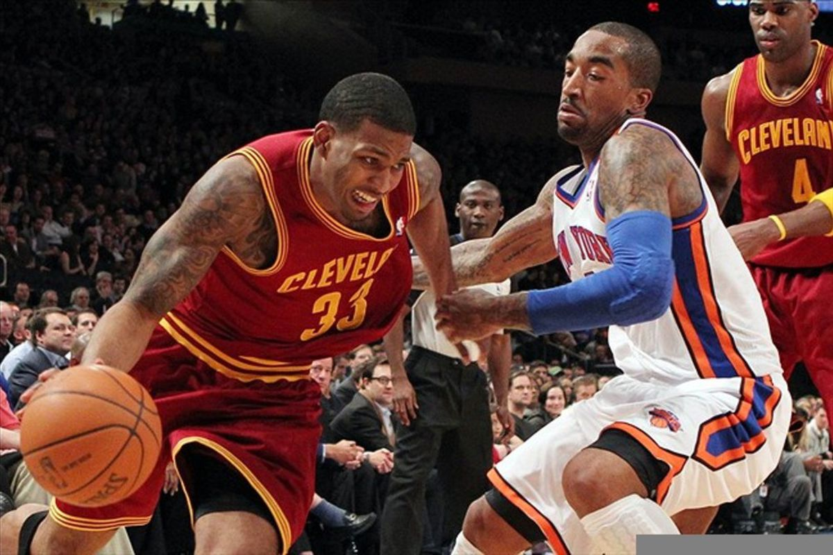 Feb 29, 2012; New York, NY, USA;  Cleveland Cavaliers small forward Alonzo Gee (33) drives past New York Knicks shooting guard J.R. Smith (8) during the first quarter at Madison Square Garden.  Mandatory Credit: Anthony Gruppuso-US PRESSWIRE