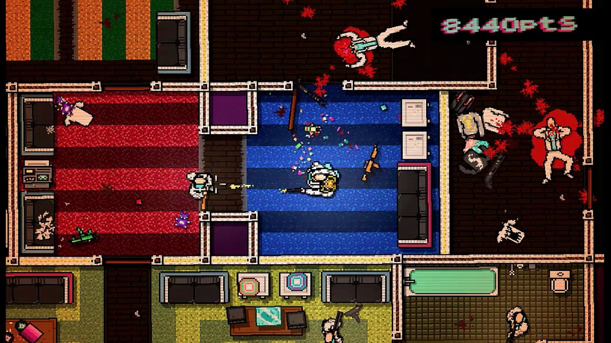 Hotline Miami - a player takes an enemy as hostage, on a floor he's filled with messy violence.