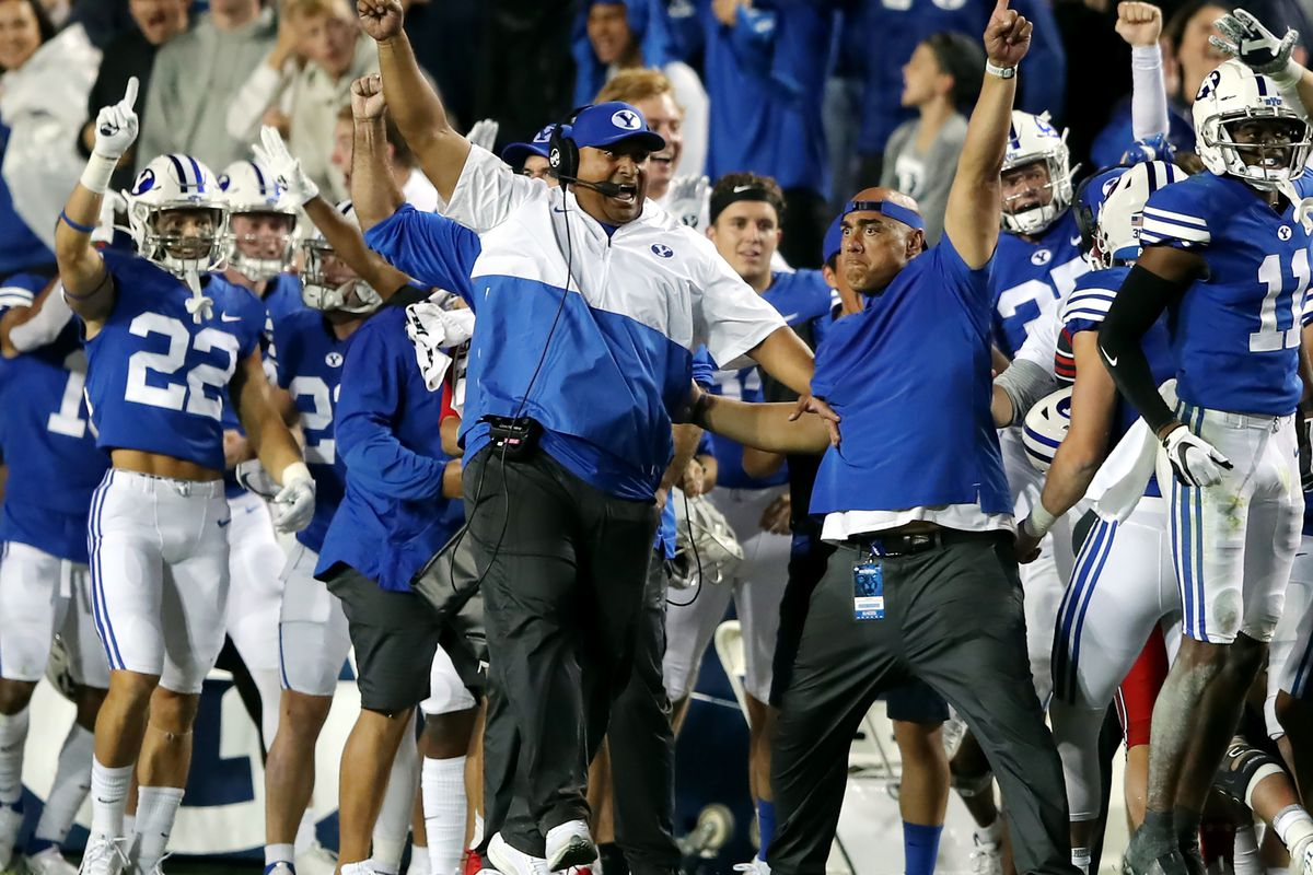 BYU head coach Kalani Sitake and the rest of the BYU sideline begin to celebrate victory over Utah at LaVell Edwards Stadium.