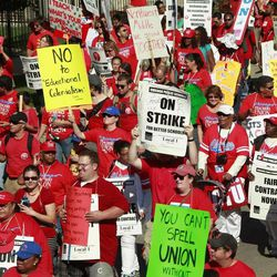 Striking Chicago school teachers march after a rally Saturday, Sept. 15, 2012 in Chicago. Thousands of striking Chicago public school teachers and their allies packed a city park Saturday in a boisterous show of force as union leaders and the district tried to work out the details of an agreement that could end a week-long walkout.