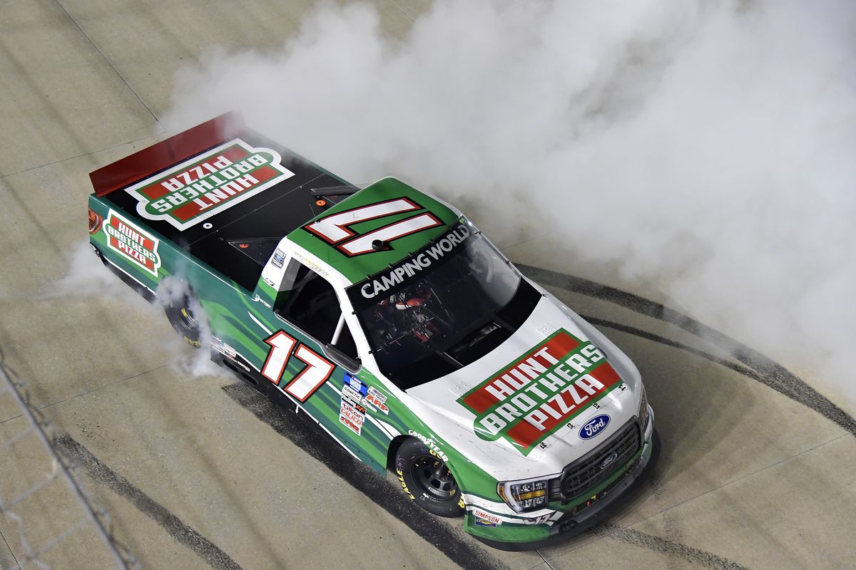 Ryan Preece, driver of the #17 Hunt Brothers Pizza Ford,celebrates with a burnout after winning the NASCAR Camping World Truck Series Rackley Roofing 200 at Nashville Superspeedway on June 18, 2021 in Lebanon, Tennessee.