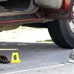 A purse and sandals lie next to the truck of a mother who was killed and her baby kidnapped, Tuesday, April 17, 2012, in Spring, Texas.  A newborn boy was abducted from his screaming mother after she was repeatedly shot outside a suburban Houston pediatric center on Tuesday, according to investigators searching for the suspected shooter who sped off with the infant in a blood-stained Lexus. (AP Photo/David J. Phillip)