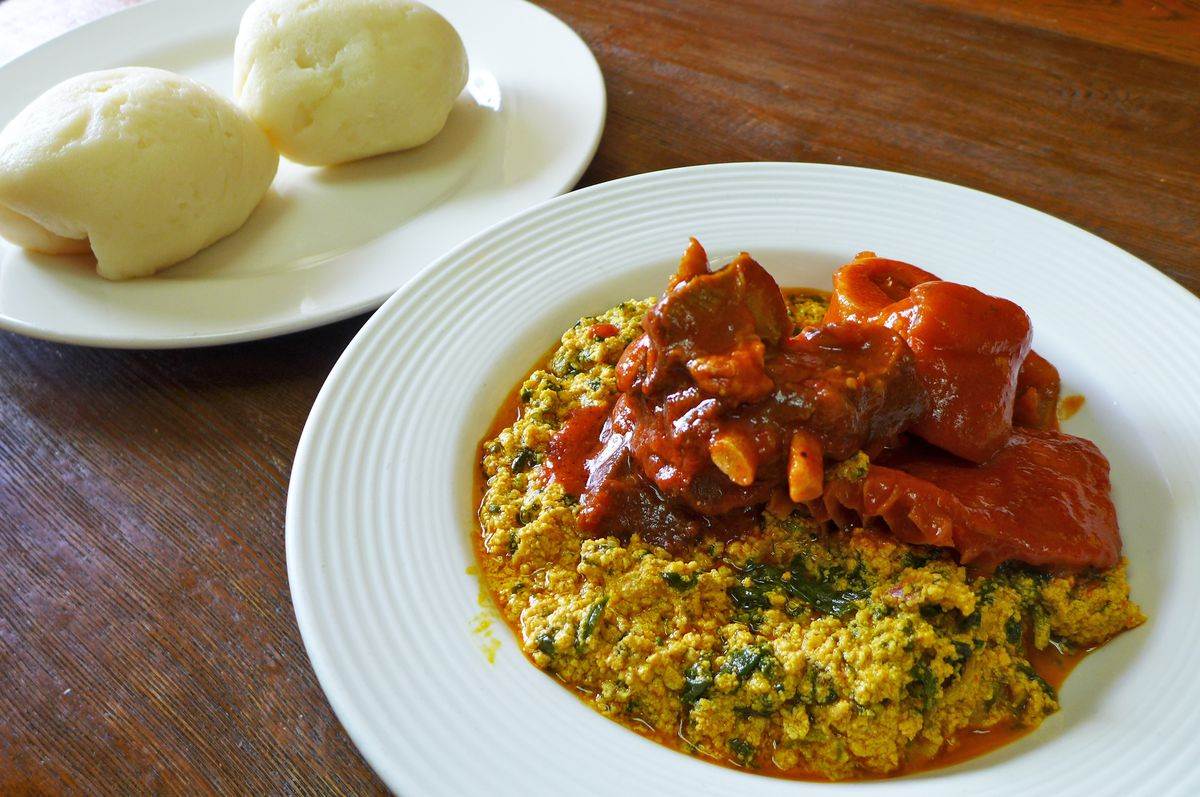 Nigerian mixed meat and egusi with fufu at Africana